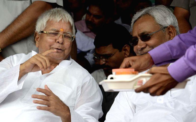 Former Chief Ministers of Bihar, RJD chief Lalu Prasad Yadav and JD-U leader Nitish Kumar during a rally in Hajipur of Bihar on Aug 11, 2014. - Lalu Prasad Yadav and Nitish Kumar