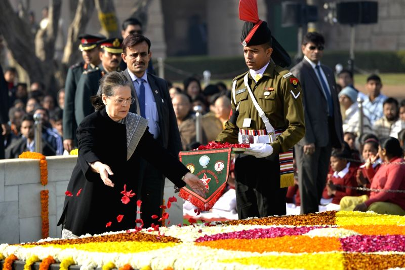 Former Congress president Sonia Gandhi paying tributes at the samadhi of Mahatma Gandhi on his death anniversary in New Delhi on Jan. 30, 2018. - Sonia Gandhi