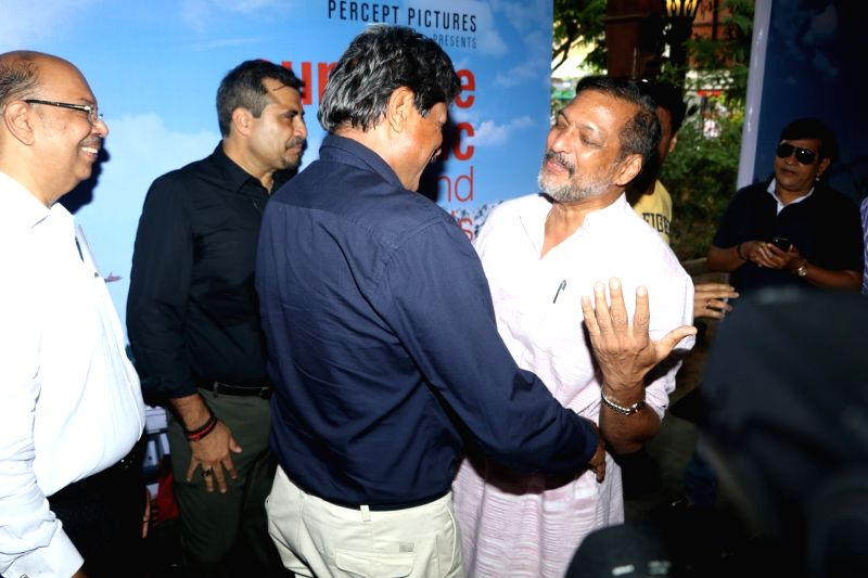 Former cricket player Kapil Dev and actor Nana Patekar during the trailer launch of film Sunshine Music Tours and Travels in Mumbai on July 25, 2016. - Nana Patekar and Kapil Dev