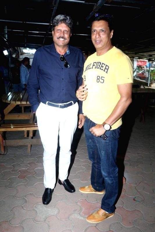 Former cricket player Kapil Dev and filmmaker Madhur Bhandarkar during the trailer launch of film Sunshine Music Tours and Travels in Mumbai on July 25, 2016. - Kapil Dev