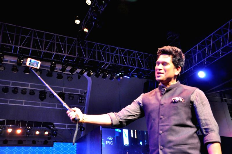 Former cricket player Sachin Tendulkar walks the ramp during the launch of the flagship True Blue store, in Mumbai on May 28, 2016. - Sachin Tendulkar