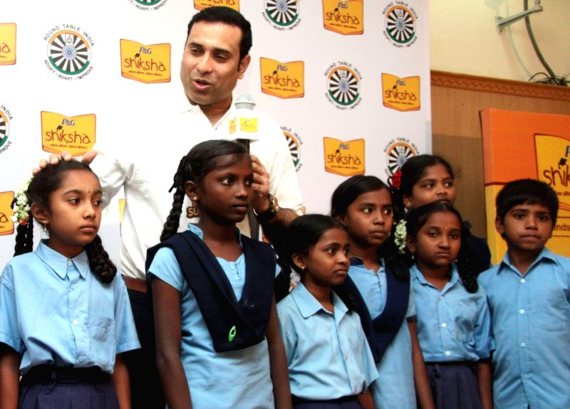 Former cricket VVS Laxman interacts with P&G Shiksha School student in Bengaluru, on May 31, 2017.