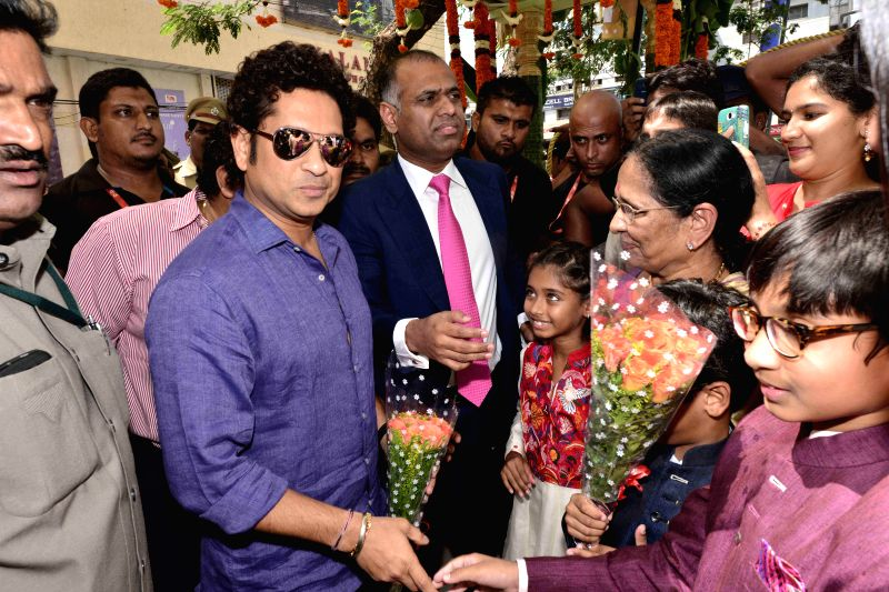 Former cricketer Sachin Tendulkar and Anushka Shetty during the launch of PVP Sqare at Vijayawada in Hyderabad on Aug. 01, 2014. (Photo: IANS). - Anushka Shetty