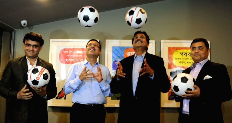 Former cricketer Saurav Ganguly with industrialists Sanjiv Goenka and Harshavardhan Neotia and Utsab Parekh during a press conference of Indian Super League in Kolkata on April 14, 2014. - Sanjiv Goenka