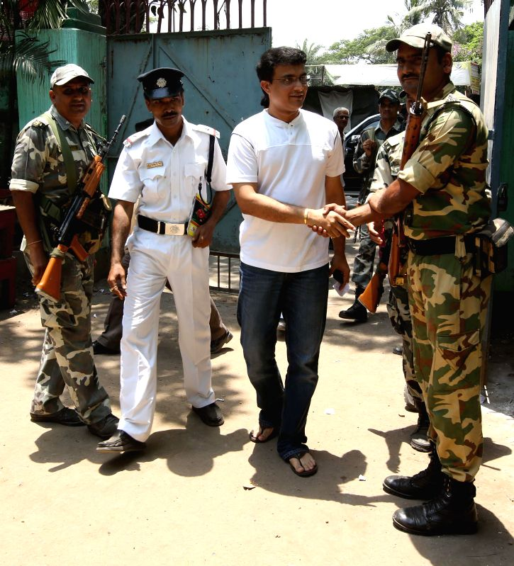 Former cricketer Sourav Ganguly arrives to cast his vote a polling booth during the ninth phase of 2014 Lok Sabha Polls in Kolkata on May 12, 2014.