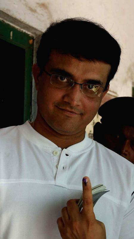 Former cricketer Sourav Ganguly shows his fore finger marked with phosphorous ink after casting his vote at a polling booth during the ninth phase of 2014 Lok Sabha Polls  in Kolkata on May 12, 2014.