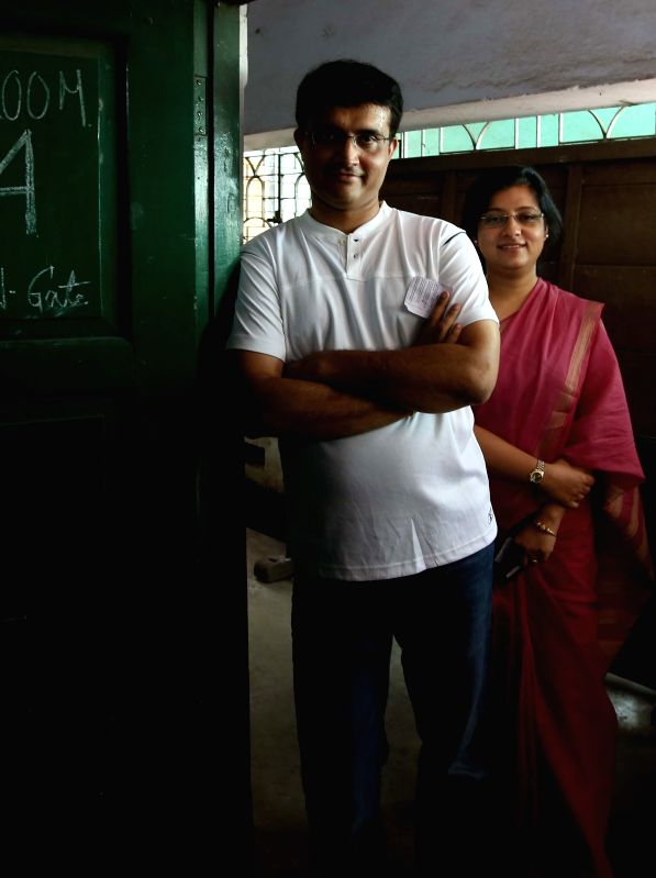Former cricketer Sourav Ganguly waits for his turn a polling booth during the ninth phase of 2014 Lok Sabha Polls in Kolkata on May 12, 2014.