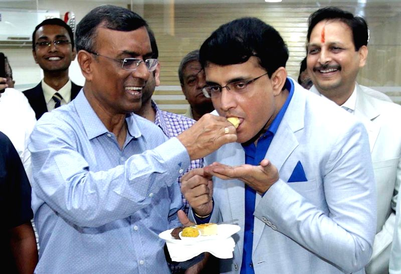 Former cricketer Sourav Ganguly with Bandhan Bank Managing Director Chandra Shekhar Ghosh during inauguration of 670th branch of the bank at Park Street in Kolkata, on May 12, 2016. - Sourav Ganguly and Chandra Shekhar Ghosh