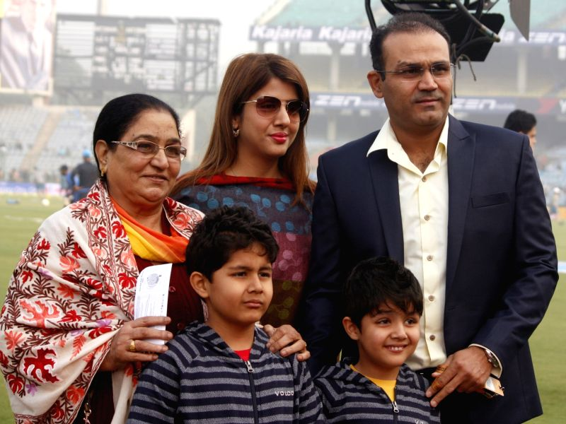 Former cricketer Virender Sehwag and his family at the Feroz Shah Kotla Stadium in New Delhi on Dec. 3, 2015.