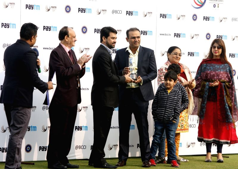 Former cricketer Virender Sehwag being felicitated by BCCI secretary Anurag Thakur during the Fourth and the final test match between India and South Africa at the Feroz Shah Kotla Stadium ...