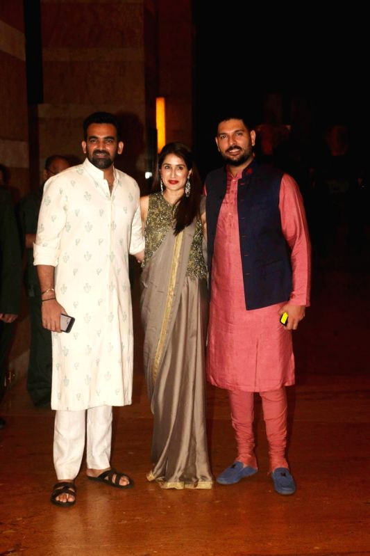 Former cricketer Zaheer Khan with his wife Sagarika Ghatge and Indian cricketer Yuvraj Singh during sangeet ceremony of All India Football Federation (AIFF) President Praful Patel's daughter ... - Zaheer Khan, Yuvraj Singh, Praful Patel and Poorna Patel