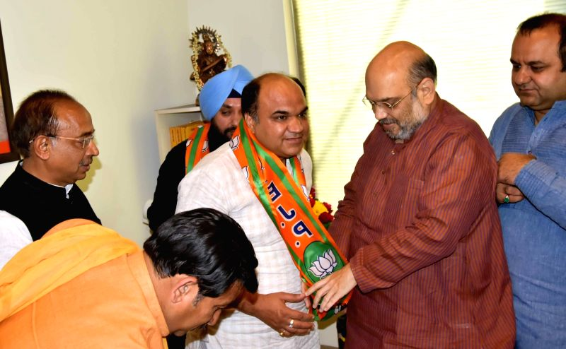 Former DPCC chief Arvinder Singh Lovely and Youth Congress president Amit Malik join BJP in presence of BJP chief Amit Shah, in New Delhi on April 18, 2017. - Malik, Arvinder Singh Lovely and Amit Shah