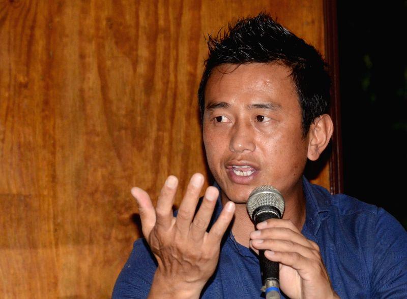Former footballer Bhaichung Bhutia addresses a press conference in Kolkata, on June 4, 2017.