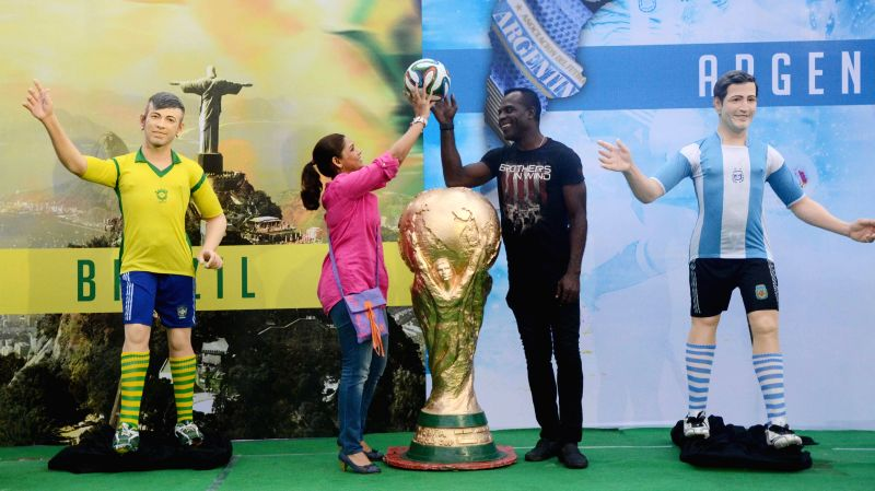 Former footballer Chima Okeria and actress Sudipta Chakraborty during inauguration of `Football Fan Park` in Kolkata on July 4, 2014. - Sudipta Chakraborty