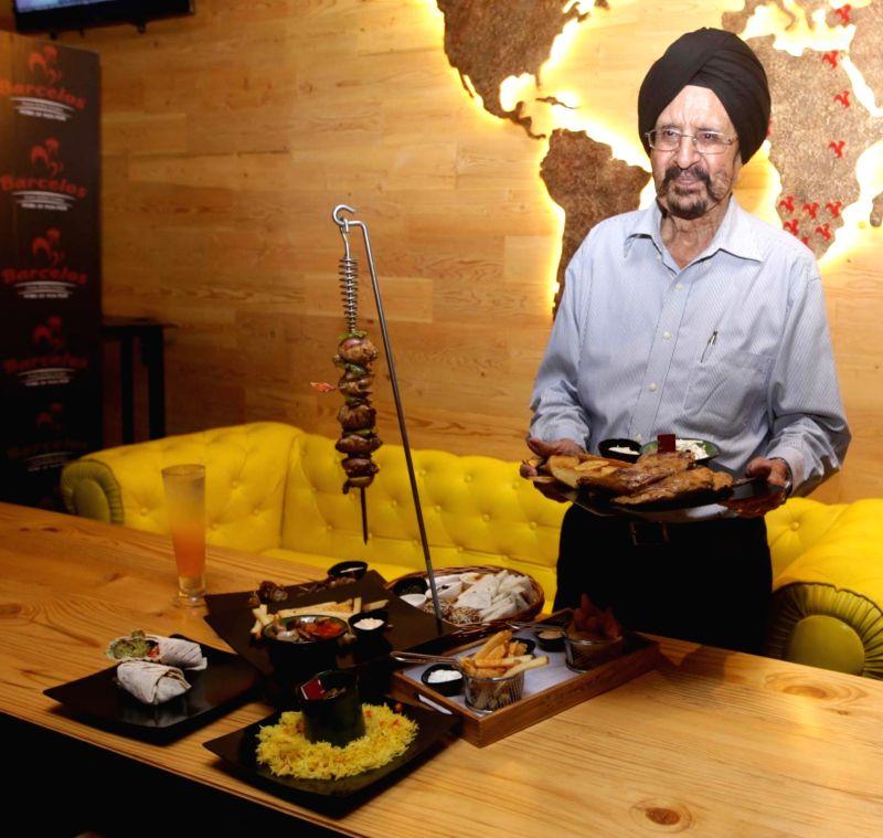 "Former Hockey player Gurbuk Singh during the inauguration of a South African restaurant ""Barcelos"" in Kolkata, on May 13, 2016. - Gurbuk Singh"