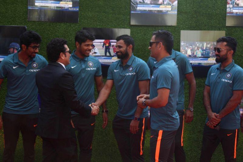 Former Indian cricket player Sachin Tendulkar greets the Indian cricket team during the premiere of film Sachin: A Billion Dreams in Mumbai, on May 24, 2017. - Sachin Tendulkar