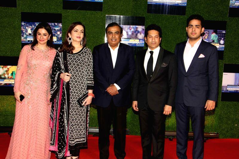 Former Indian cricket player Sachin Tendulkar with his wife Anjali Tendulkar, Mukesh Ambani, CMD, Reliance Industries Ltd along with his wife Nita Ambani and son Akash Ambani during the ... - Sachin Tendulkar, Mukesh Ambani, Nita Ambani and Akash Ambani