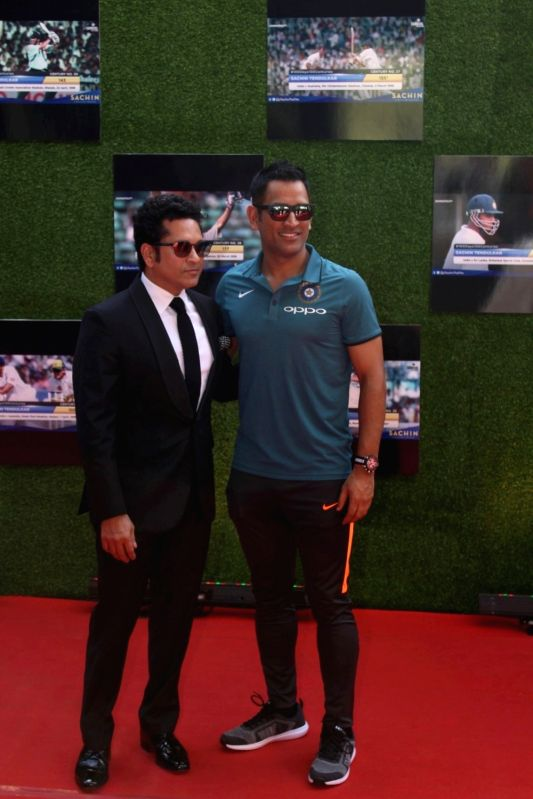 Former Indian cricketer Sachin Tendulkar and Mahendra Singh Dhoni during the special screening of film A Billion Dreams in Mumbai, on May 23, 2017. - Sachin Tendulkar and Mahendra Singh Dhoni