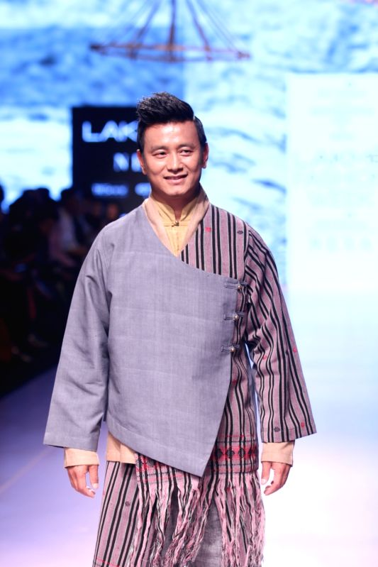 Former Indian football captain Bhaichung Bhutia walks the ramp for label Kuzu by designer Karma Sonam during the Lakme Fashion Week Summer/Resort 2018 in Mumbai on Feb 1, 2018. - Bhaichung Bhutia