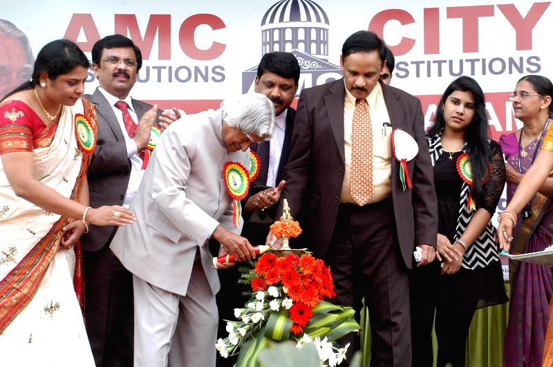 Former Indian President APJ Abdul Kalam lights the inaugural lamp during a seminar on 'Role of Youth in Nation Building' in Bangalore on May 2, 2014.