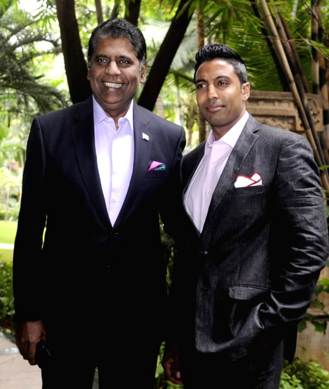 "Former Indian tennis player Vijay Amritraj with his son Prakash Amritraj and Jacob John, Brand Head of Louis Philippe during a press conference announcing the show ""In Pursuit with Excellence,' ."