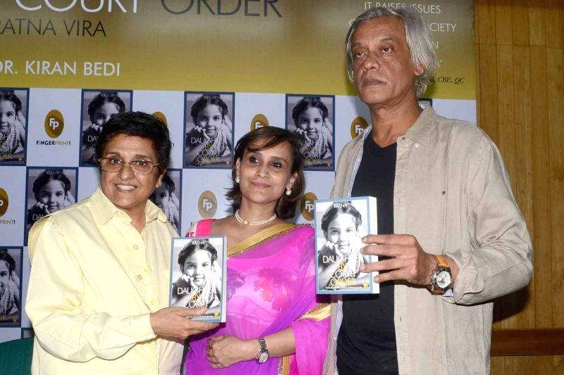 Former IPS officer and social activist Kiran Bedi and filmmaker Sudhir Mishra with author Ratna Vira during launch of Vira's book `Daughter by Court Order` in New Delhi on June 25, 2014. - Kiran Bedi and Sudhir Mishra