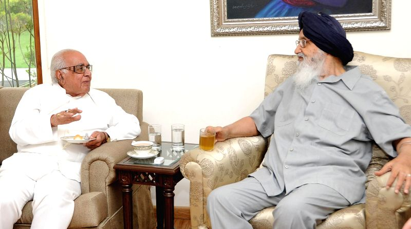 Former Karnataka Governor Bhanu Pratap Singh during a meeting with Punjab Chief Minister Parkash Singh Badal in Chandigarh on July 1, 2014. - Parkash Singh Badal