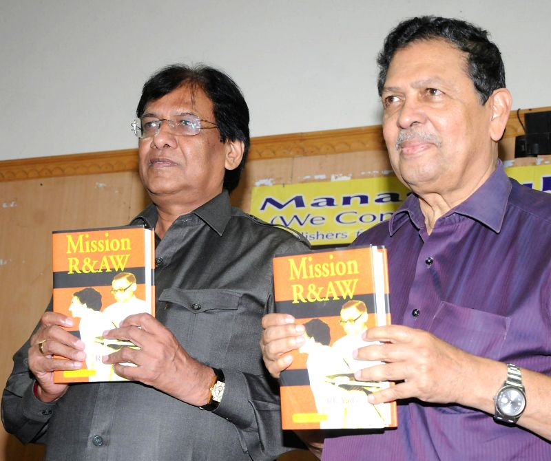 Former Lokayukta Justice N Santosh Hegde releases 'Mission R&AW' authored by RK Yadav former R&AW officer at Press Club in Bangalore on July 23, 2014.