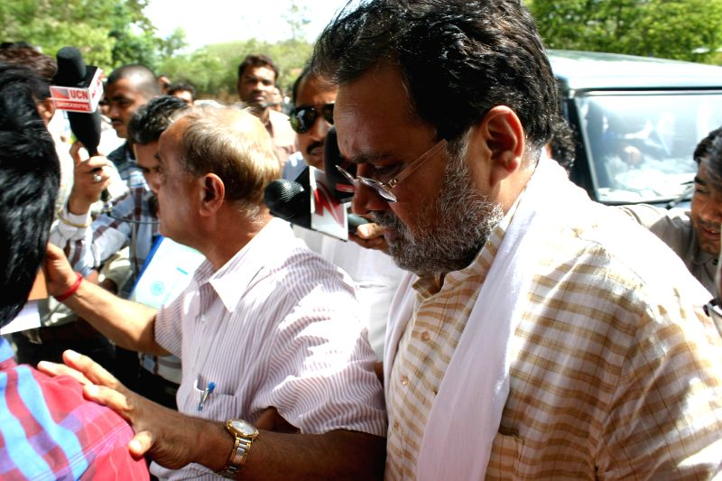 Former Madhya Pradesh minister Laxmikant Sharma being taken to be produced in a district court in connection with Madhya Pradesh Professional Examination Board (Vyapam) scam in Bhopal on June 24, ...