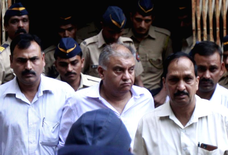 Former media baron Peter Mukerjea, one of the prime accused in the Sheena Bora murder case being taken to be produced before a Mumbai court on Dec 1, 2015.