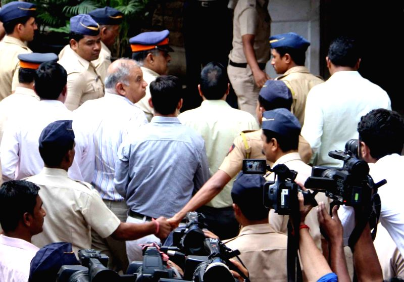 Former media tycoon Peter Mukerjea, who has been arrested in connection with the murder of his step-daugther Sheena Bora at being taken to be produced at a CBI Court in Mumbai, on Nov 23, ...