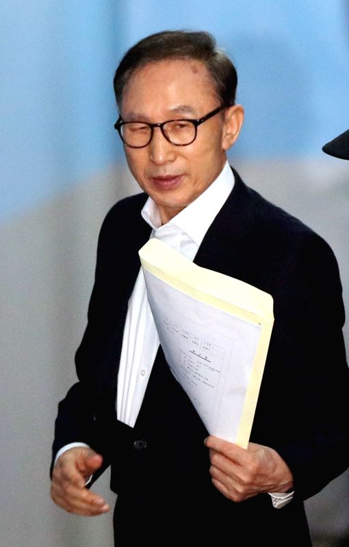 Former President Lee Myung-bak arrives at the Seoul Central District Court on May 23, 2018, to attend the first hearing over bribery, embezzlement, tax evasion and other charges. It marks ...