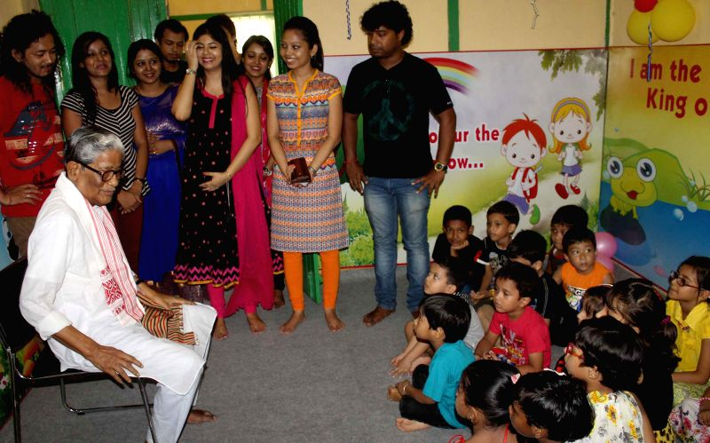 Former president of Asom Sahitya Sabha Birendra Nath Datta interacts with kids at a summer camp in Guwahati on July 3, 2014.