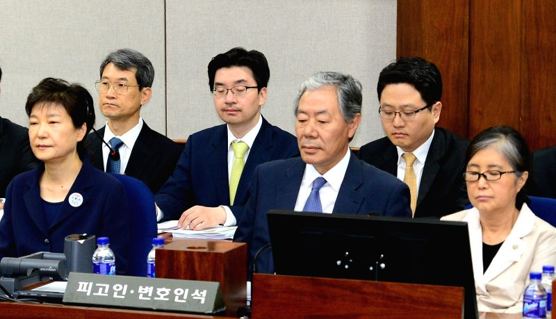 Former President Park Geun-hye (L) and her now-jailed confidante Choi Soon-sil (R) sit in a courtroom in the Seoul Central District Court on May 23, 2017, to stand trial over a string of ...