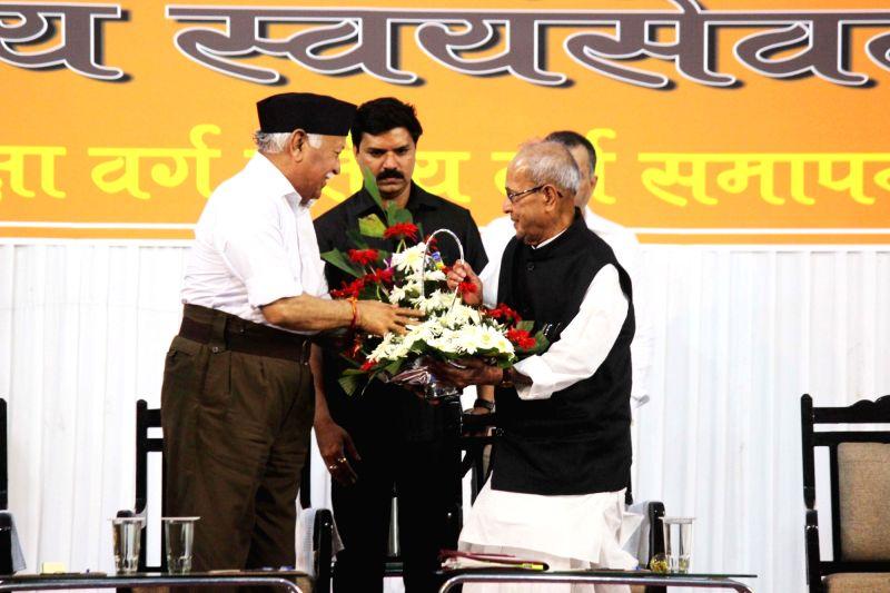 "Former President Pranab Mukherjee being greeted by RSS chief Mohan Bhagwat at the concluding function of ""Tritiya Varsh Varg"" in Nagpur on June 7, 2018. - Pranab Mukherjee"