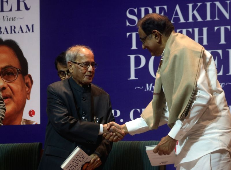 "Former President Pranab Mukherjee interacts with Congress leader P Chidambaram after releasing a book titled ""Speaking Truth to Power"" authored by P Chidambaram in New Delhi on ... - Pranab Mukherjee"