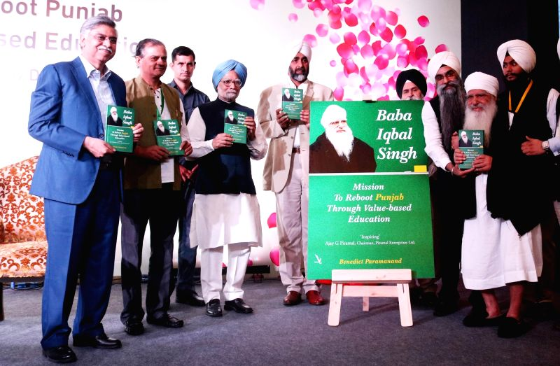Former Prime Minister Dr Manmohan Singh and Chairman of Hero Corporate Service Sunil Kant Munjal at the launch of Baba Iqbal Singh's  book Mission to Reboot Punjab Through Value - Based ... - D, Manmohan Singh and Iqbal Singh
