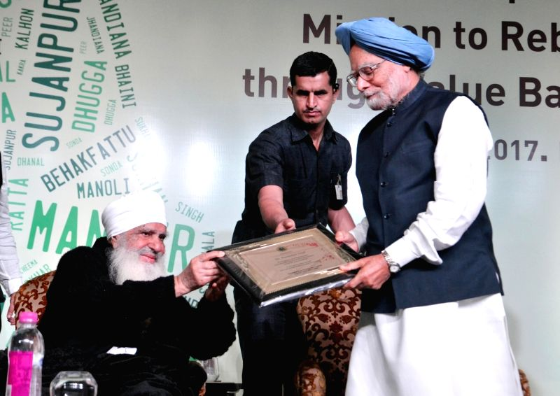 Former Prime Minister Dr Manmohan Singh at the launch of Baba Iqbal Singh's  book Mission to Reboot Punjab Through Value - Based Education in New Delhi on April 8, 2017. - D, Manmohan Singh and Iqbal Singh