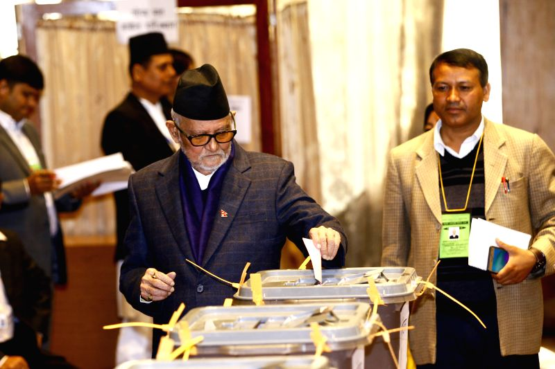 Former Prime Minister of Nepal Sushil Koirala (L) votes at the Parliament in Kathmandu, Nepal, Oct. 31, 2015. Nepal's first vice-presidential election after the ...