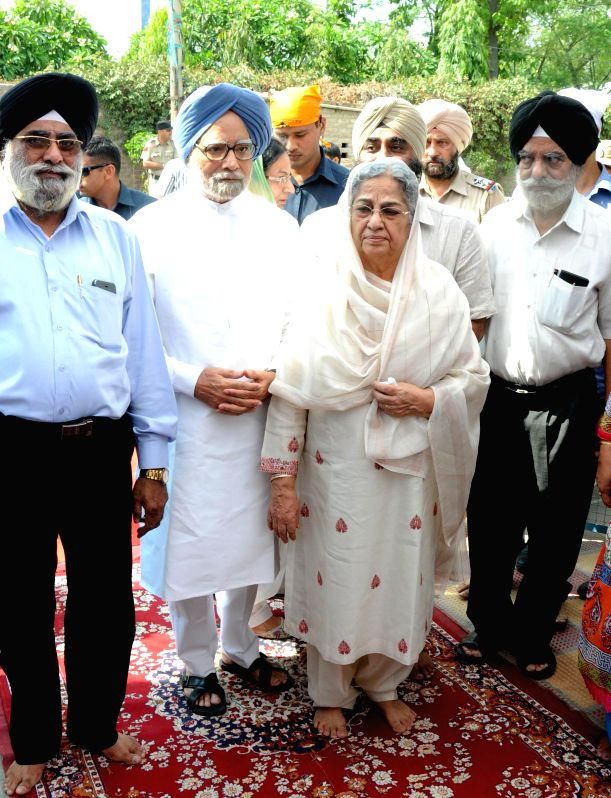 Former Prime Minster Manmohan Singh with his wife Gursharan Kaur attends a bhog ceremony of one of his relatives in Amritsar on July 11, 2015. - Gursharan Kaur