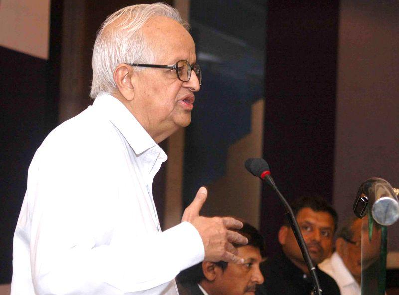 Former Reserve Bank of India Governor Bimal Jalan addresses during a programme on 'State of Indian Economy-Politics and Governance' in Kolkata on April 14, 2014.