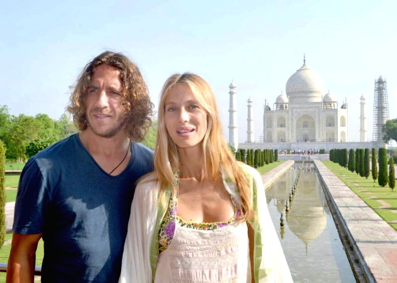Former Spanish footballer Carles Puyol with his wife Vanessa Lorenzo visit the Taj Mahal in Agra on May 18, 2017.