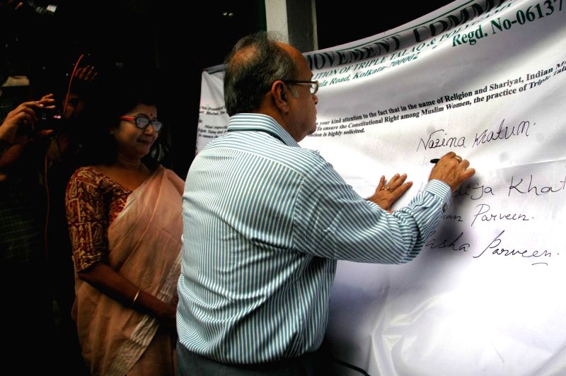 Former Supreme Court judge Justice Ashok Ganguly signs a mass petition during a convention organised by Joint Movement Committee demanding abolition of Triple Talaq and Polygamy at Press ...