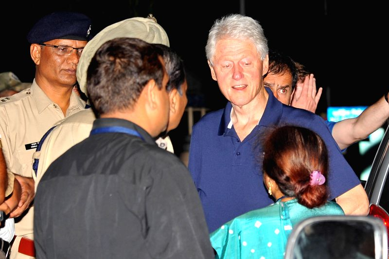 Former US President Bill Clinton arrives at Jaipur Airport on July 14, 2014.