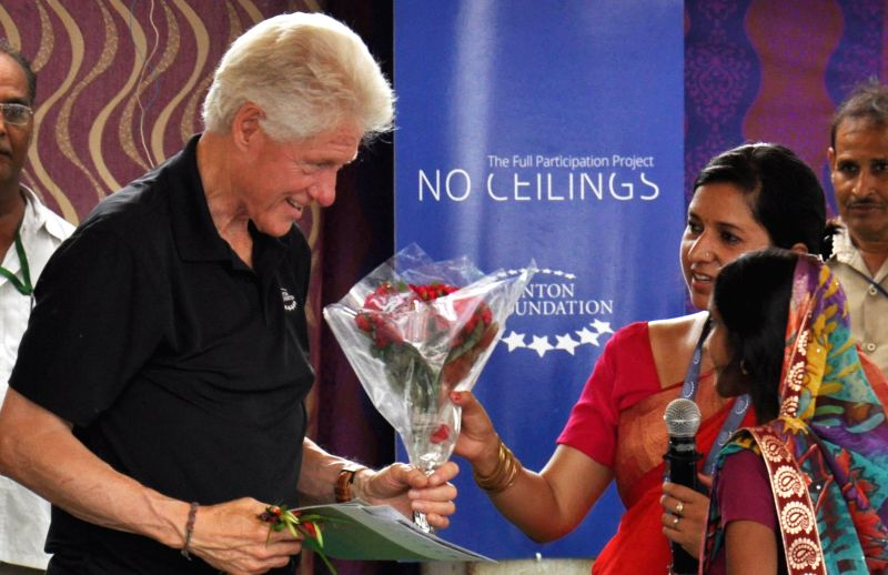Former US President Bill Clinton being felicitated in a village of Uttar Pradesh where his organisation is working to check diarrhea on July 17, 2014.
