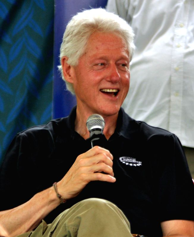 Former US President Bill Clinton during his visit to a village of Uttar Pradesh where his organisation is working to check diarrhea on July 17, 2014.