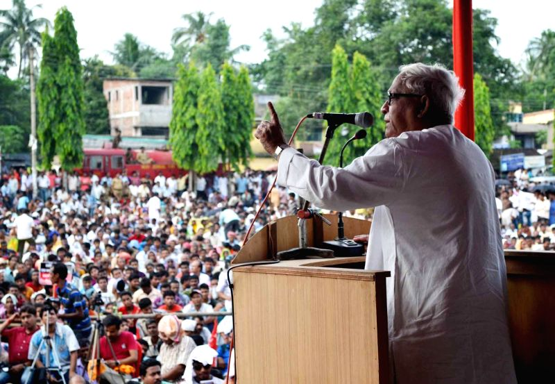 Former West Bengal Chief Minister and Communist Party of India-Marxist (CPI-M) leader Buddhadeb Bhattacharya addresses a mass meeting in South 24 Parganas district of West Bengal on July 6, 2014.