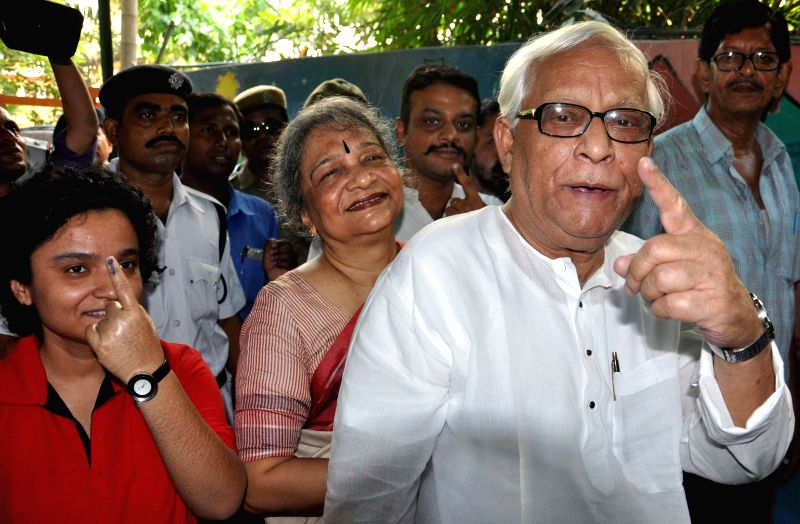 Former West Bengal Chief Minister and CPI-M leader Buddhadeb Bhattacharjee shows his fore finger marked with phosphorous ink after casting his vote at a polling booth during the ninth phase of 2014 ..