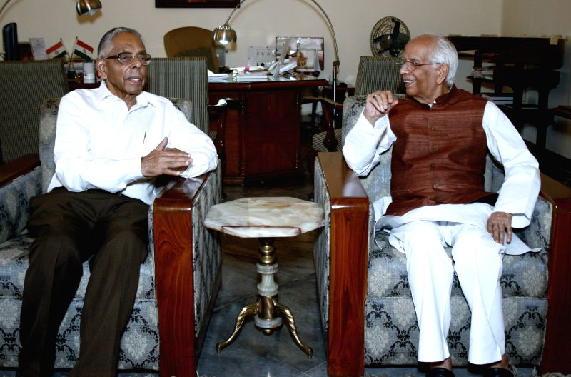 Former West Bengal Governor M K Narayanan with the current governor of the state  Keshari Nath Tripathi during a courtesy meeting at the Raj Bhawan in Kolkata, on March 27, 2015.