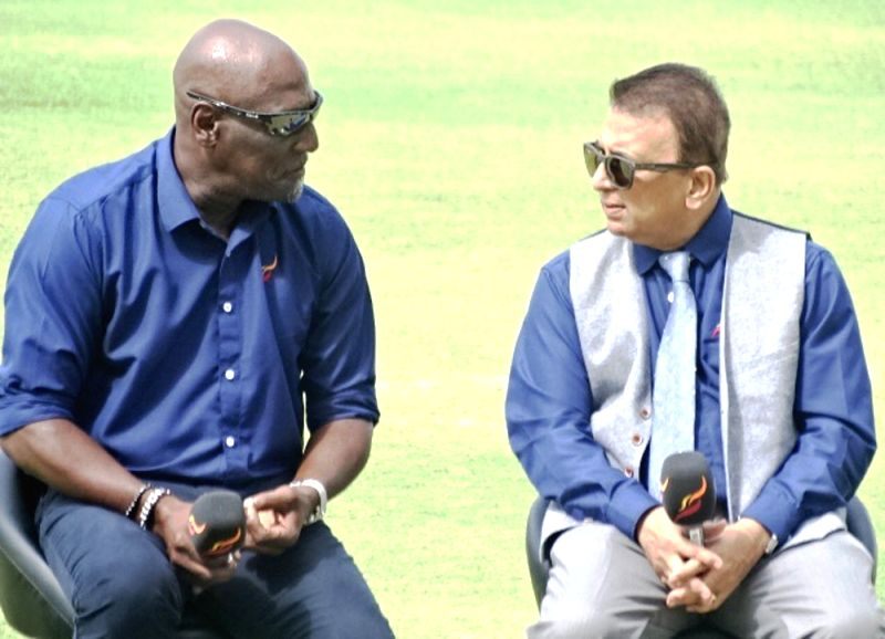 Former West Indies cricketer Sir Vivian Richards and Former Indian cricketer Sunil Gavaskar during the first test match between India and West Indies at Sir Vivian Richards Stadium in ...